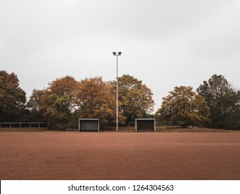 Symmetrical shot of a Rural Cinder soccer pitch in Germany