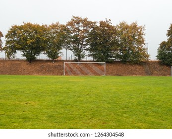 symmetrical shot of Rural grass soccer pitch in Germany