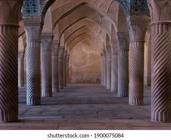 Symmetrical spiral columns in a hall of  Vakil mosque in Shiraz, Iran. - Shutterstock ID 1900075084