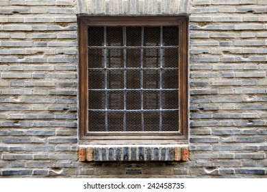 Symmetrical window in a facade of a building. Horizontal composition