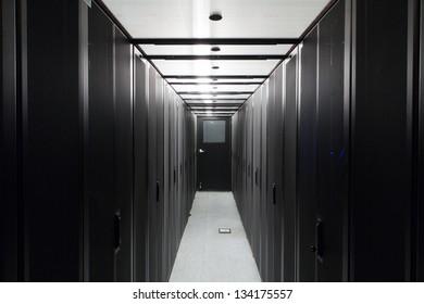Symmetrically telecommunication racks in a sealed corridor.