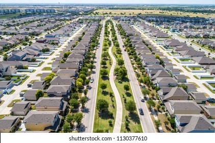 Symmetry modern development Pflugerville, Texas suburbia Homes and huge real estate development in neighborhood with modern layout and design, long perspective divide