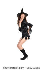 Sympahetic girl dressed as a witch on a white background