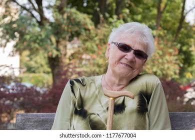 Sympathetic elderly woman with sunglasses