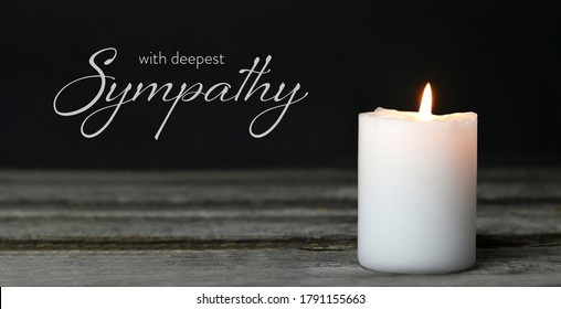 Sympathy card. Memorial candle on wooden background