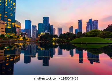 Symphony Lake KLCC during Sunrise With Clear Reflection.Soft Focus due to Long Exposure.