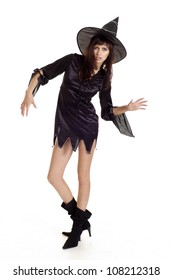 Sympohetic girl dressed as a witch on a white background