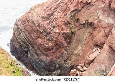 Syncline in above Mudstone and Sandstone Rock cliff, Cobblerâ??s Hole, St Annâ??s Head, Dale, Pembrokeshire, Wales, United Kingdom.