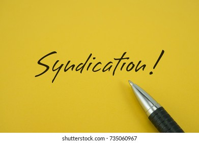 Syndication! note with pen on yellow background