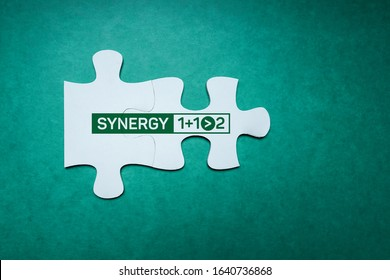Synergy 1+1>2 jigsaw puzzle. Business Concept