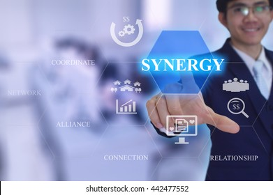 SYNERGY  concept presented by  businessman touching on  virtual  screen