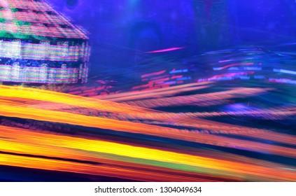 synth wave vapor wave chill disco lights neon lights fairground ride night lights funfair disco light trails, slow shutter-speed  illuminations futuristic sci fi wi copy space stock, photo, photograph