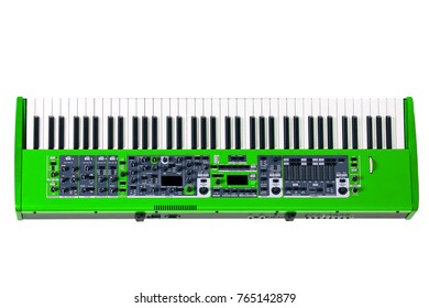 Synthesizer of green color with wooden inserts the isolated on a white background, high-class musical instrument with regulators of settings of sounding of the tool.