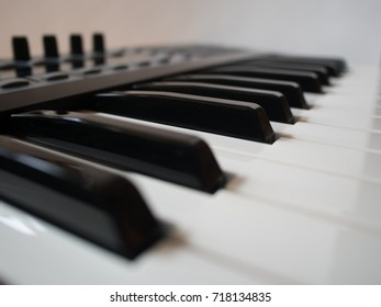 Synthesizer keys closeup view. Shallow depth of field.