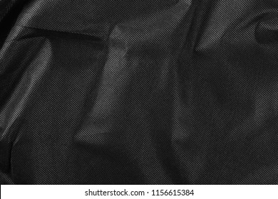 Synthetic black nylon fabric, cloth background and texture