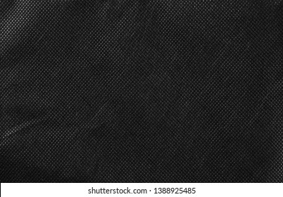 Synthetic black nylon fabric, cloth texture background