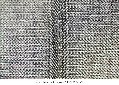 Synthetic thick dark gray fabric with a center seam
