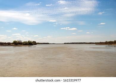 The Syr Darya River in April in Kyzylorda Oblast of southern Kazakhstan - Shutterstock ID 1615319977