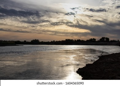 The Syr Darya River at sunset in May in Kyzylorda Oblast of southern Kazakhstan - Shutterstock ID 1604365090