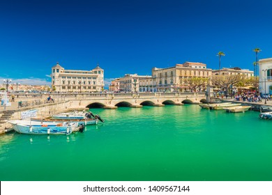 Syracuse - April 2019, Italy: View of the canal and Umbertino bridge between Syracuse and Ortygia