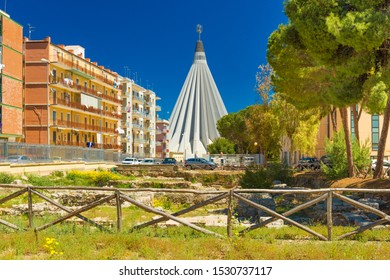 Syracuse - April 2019, Italy: View of The Sanctuary of the Madonna delle Lacrime (Madonna of the Tears) and the ancient Greek architecture ruins in the foreground