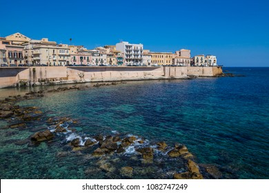 Syracuse - coast, italy, promenade  Coast of Ortigia island at city of Syracuse, Sicily, Italy. Beautiful travel photo of Sicily.