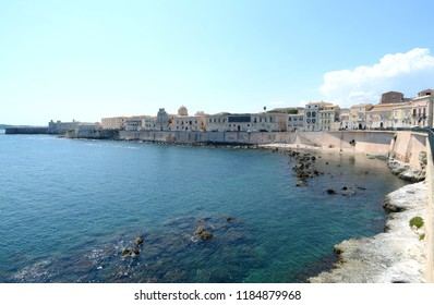 Syracuse is a greek city in Sicily where Archimedes was born. It is known for the ruins of antiquity. Here the   peninsula of Ortigia which is the ancient center and the Maniace castle.