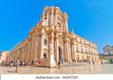 SYRACUSE, ITALY - AUGUST 16, 2014: tourists and locals visit main square Piazza del Duomo in Ortigia, Syracuse, Italy. Ortigia is a small island which is the historical centre of the city of Syracuse