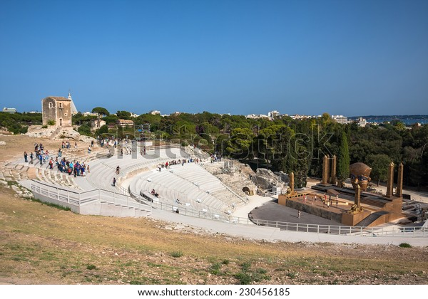 Syracuse, ITALY - JULY 6, 2014: View of ancient greek theater in Syracuse, Italy. It is one of the best preserved theaters and landmark in Sicily