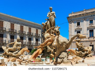 SYRACUSE, ITALY - JUNE 12, 2016: Diana fountain (installed by Giulio Moschetti  in 1907) on piazza Archimede. Beautiful travel photo of Sicily.