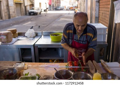 Syracuse, Italy - June 29 2017: The famous sandwich shop Caseificio Borderi in the market of Ortigia. The budget and high price value ratio sandwich is served by the owner.