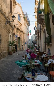 Syracuse, Italy - June 29 2017: The narrow street of the famous historic town Syracuse, Sicily.