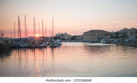 Syracuse, Italy - June 29 2017: The sunset view of historic port of Syracuse, Sicily.