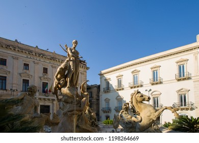 Syracuse, Italy - June 29 2017: The Fountain of Diana at Piazza Archimede in the historic town Syracuse, Sicily.