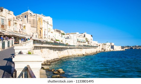 SYRACUSE, ITALY - MAY 18, 2018: view of Ortigia area, downtown of Syracuse, Sicily, at the beginning of  summer season