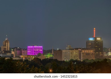 SYRACUSE, NEW YORK - JULY 13, 2019: Night View of Downtown Syracuse Cityscape with the Barclay Damon Building and Axa Tower in background.