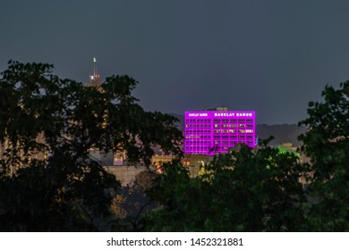 SYRACUSE, NEW YORK - JULY 13, 2019: Night View of the Barclay Damon Building, Illuminated with LED Lights the Building's Color.