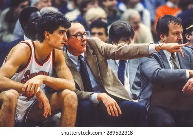 SYRACUSE, NEW YORK, USA - Coach Jim Boeheim talks to player Rony Seikaly during Syracuse Orangemen college NCAA basketball game in Carrier Dome, 1980s