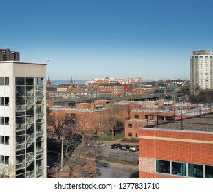 Syracuse, New York, USA. January 4, 2019. View looking north from the Syracuse University hill of downtown Syracuse ,  and the city's northside with Onondaga Lake in the far distance