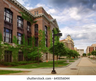 Syracuse, New York, USA. May 21, 2017. Syracuse University Campus on Sims Drive  with Bowne Hall, The Carnegie Library and , in the distance, The Carrier Dome