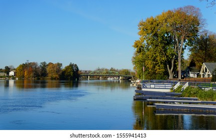 Syracuse, New York, U.S.A - October 22, 2019 - The view of the bridge and boat docks on Oneida Lake overlooking the stunning colors of fall foliage