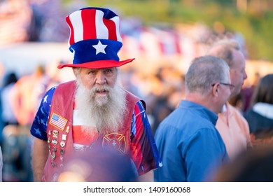 Syracuse, New York/USA - May 26,2019: A war veteran dressed as uncle sam moves through a crowd at the Watch Fire Ceremony