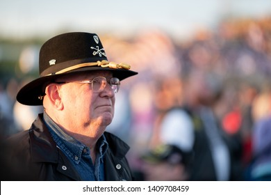 Syracuse, New York/USA - May 26,2019: An old Army Cavalry veteran looks at the stage at the watch fire ceremony