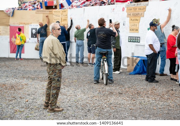 Syracuse, New York/USA - May 26,2019:A veteran looks on as people write on the memorial wall at the watch fire ceremony in Syracuse, New York.