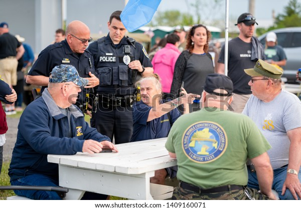 Syracuse, New York/USA - May 26,2019:A Woman is angered at being asked to leave a table reserved for disabled veterans.