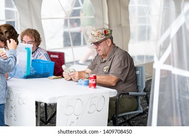 Syracuse, New York/USA - May 26,2019:An old veteran counts money at a 50/50 raffle raising money for the watch fire ceremony.