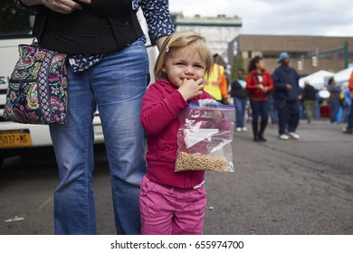 Syracuse, Ny 06/02/2017: A little girl enjoys her cherios. At the taste of Syracuse.