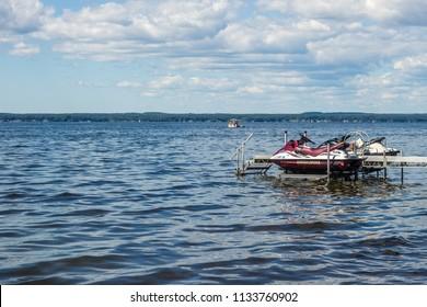 SYRACUSE, NY JULY 7TH, 2018 - Sea-doo jet skis and people having fun on a boat on Oneida Lake, NY State.