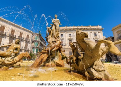Syracuse, Sicily - Aug 2018. View of the Fountain of Diana in Archimedes Square in Ortigia. Built by Giulio Moschetti in 1907, this classic fountain features a statue of the goddess Diana.