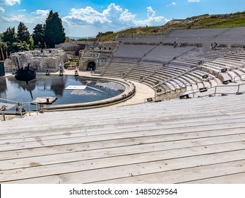 Syracuse, Sicily, Italy 04 June 2019:  Ruins of Greek theater in Neapolis Archaeological Park in Syracuse (Siracusa), Sicily Island of Italy , Greek history, culture, architecture.